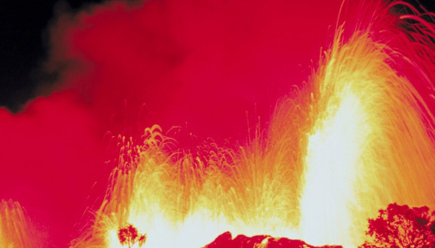 Explosive eruptions emit gases and fragmented rock into the air.