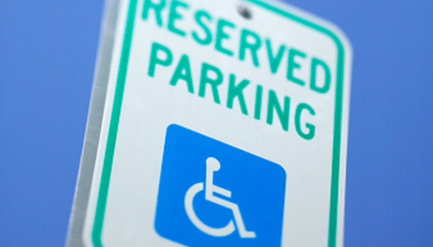 Handicap spots are identified with the international symbol for accessibility.