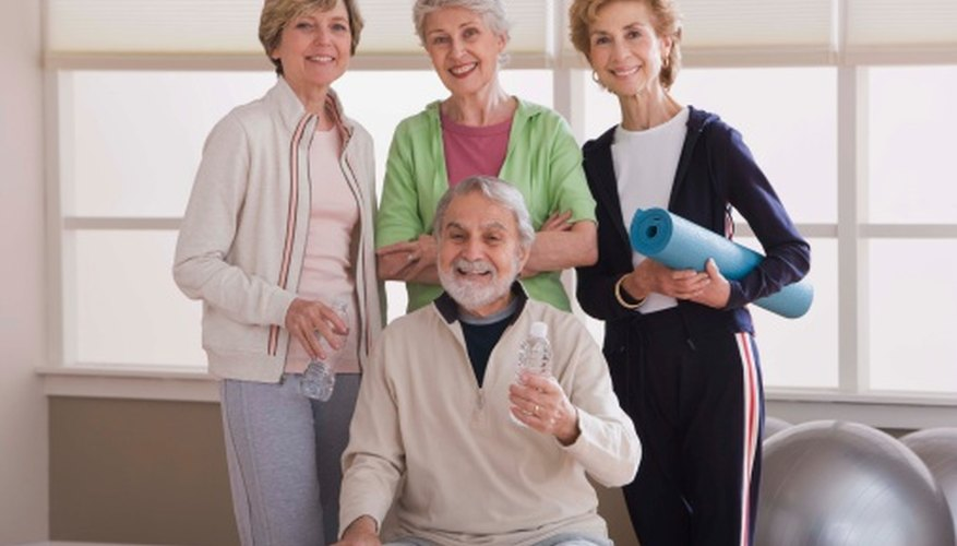 An activity aide may assist in senior exercise programs.