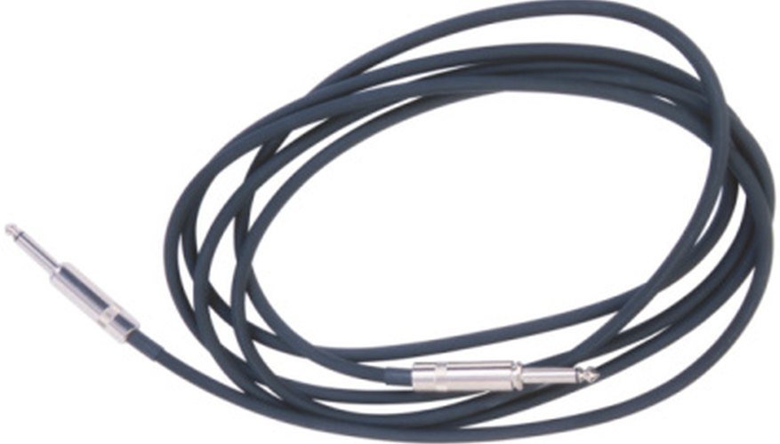 Connect the pedal to your guitar and amp with standard instrument cables.