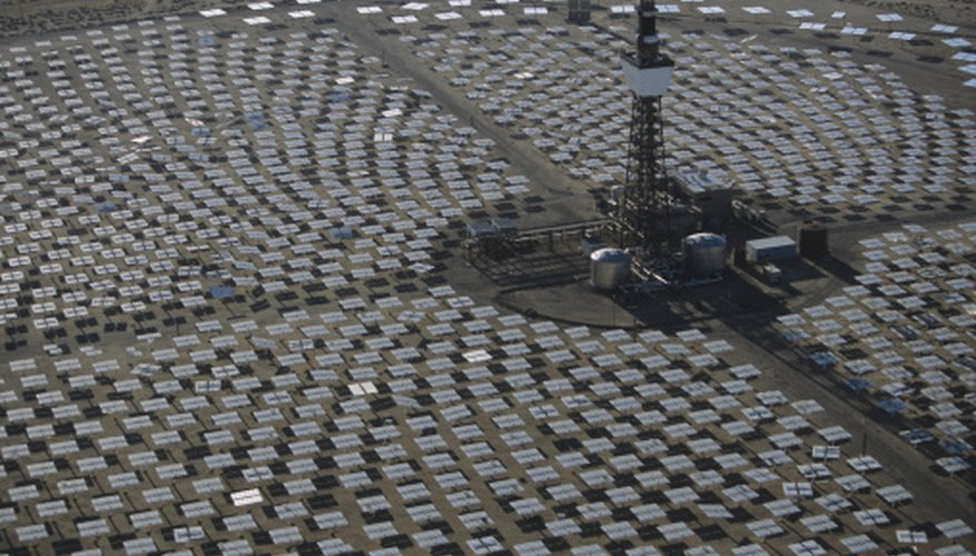 This field of mirrors concentrates solar energy on a tank, heating the liquid to drive a turbine.