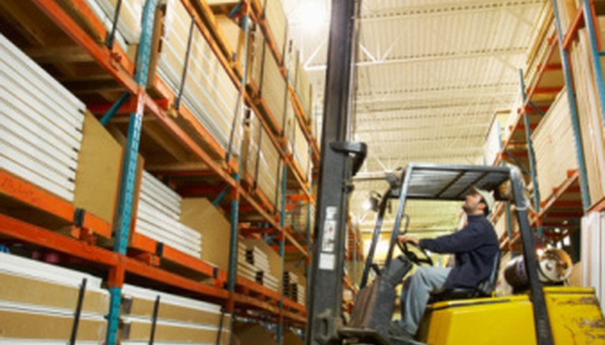 Warehouse workers use forklifts to move goods.