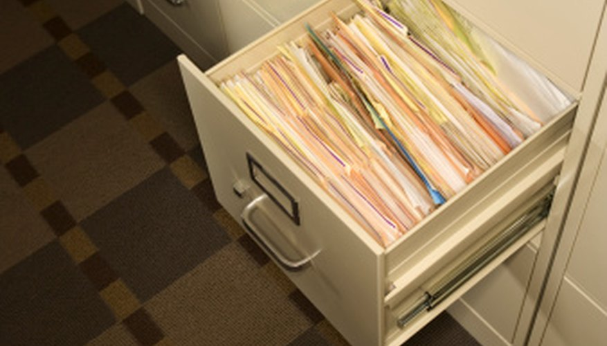 Organize your file cabinets with hanging folders.