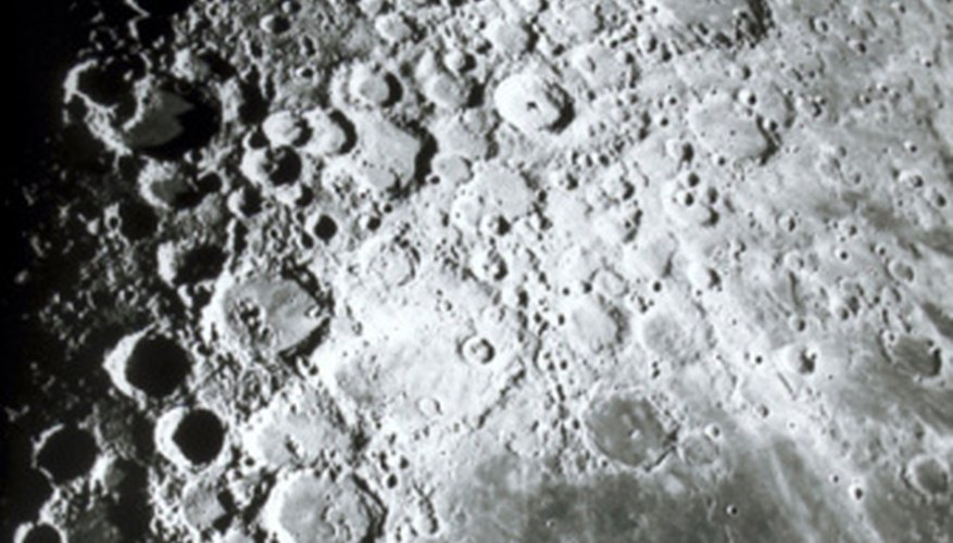 The surface of the moon is covered in craters left by meteorites.