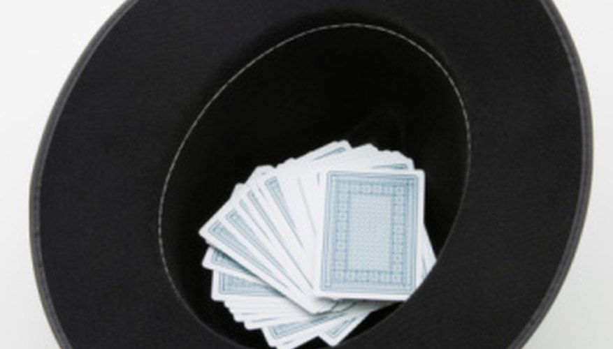 A hat can be used during performances to dispose of cards without leaving a large mess.