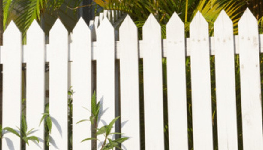 Use the shape of a picket fence to hide cords along the baseboard.