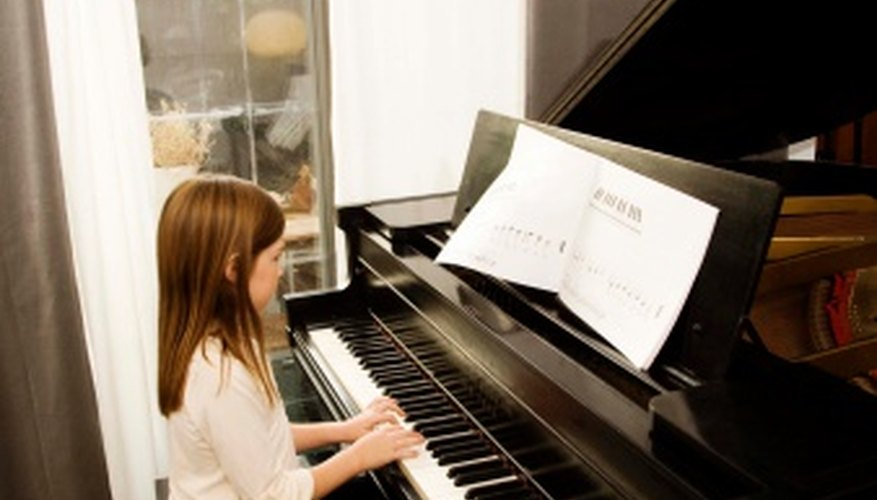 On a piano, lower notes are played by the left hand, higher notes by the right.