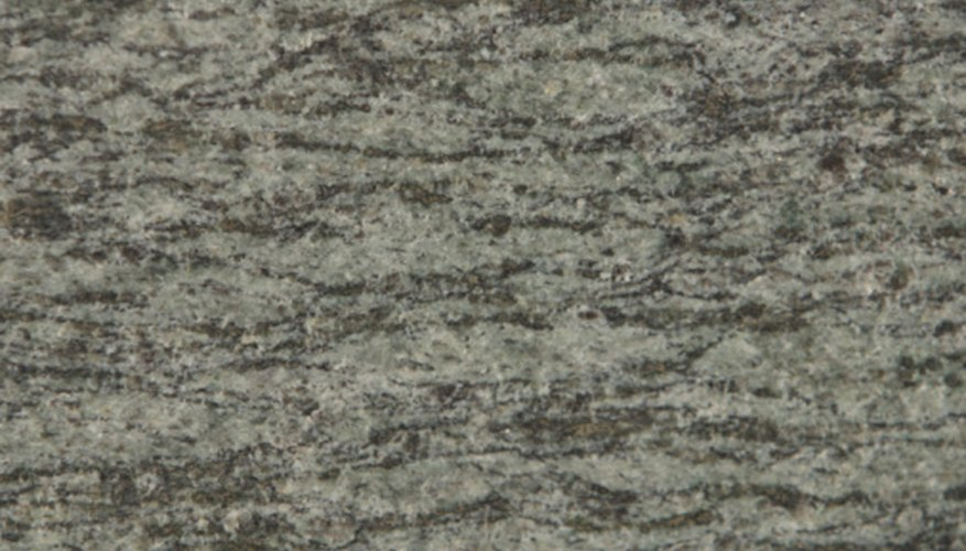 Granite rock is a coarse intrusive igneous rock that is formed when magma from continental crust cools over millions of years.
