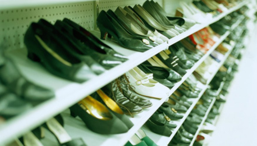 Shoes in thrift stores can also be organized on display racks by color and size.