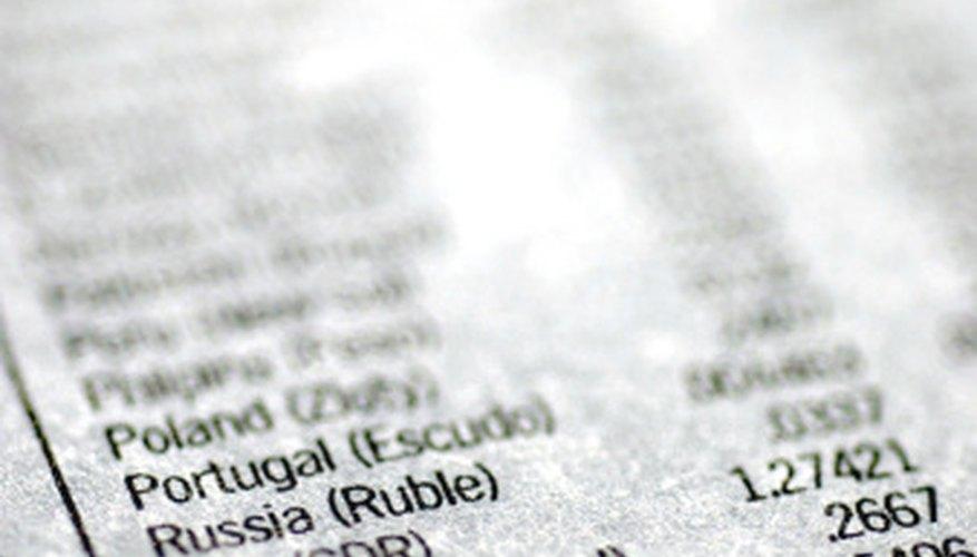 Puedes encontrar los tipos de cambio en un periódico de negocios.