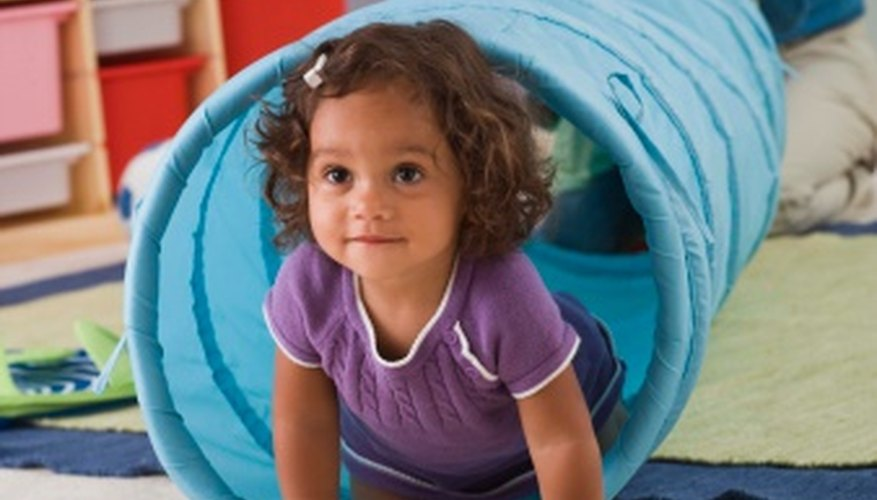 Harness your toddler's energy and help her develop life skills by playing age-appropriate games with her.