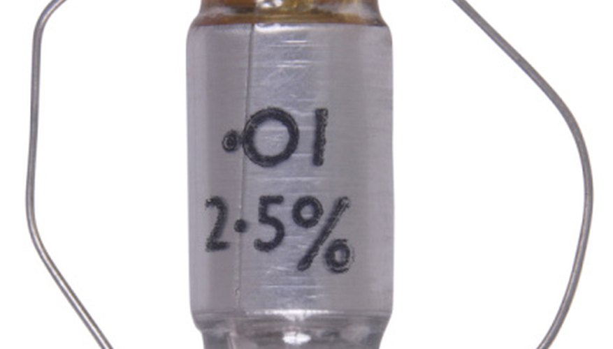 A large capacitor will hold enough charge to be dangerous—never touch the leads of a charged capacitor.