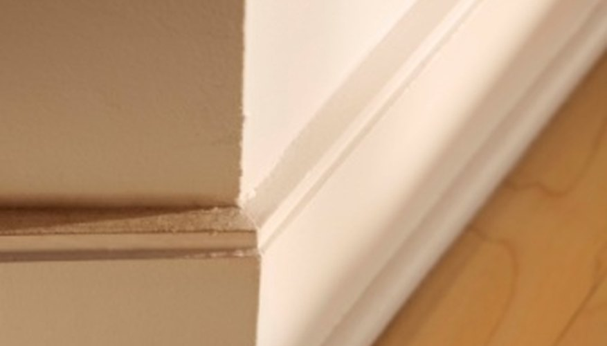 Layer stock molding to creative elaborate baseboards.