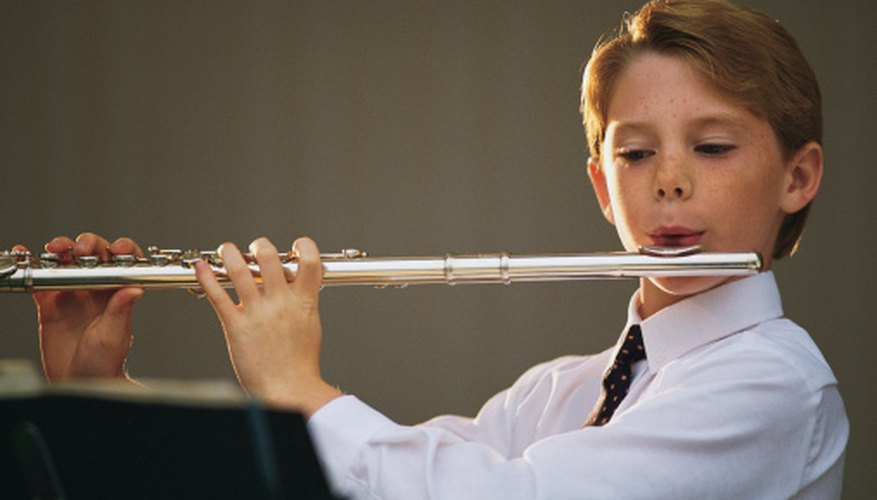 This boy knows how to hold the flute out properly.
