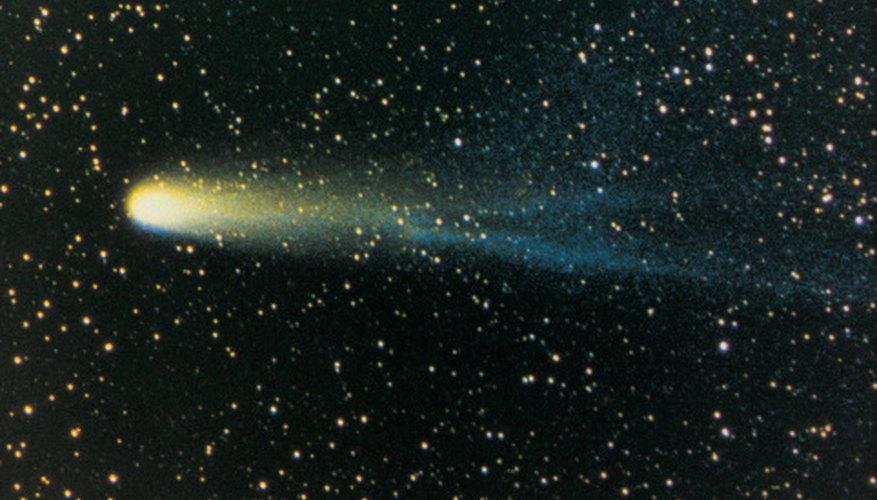 Comets approaching the sun develop luminous tails that extend for long distances.