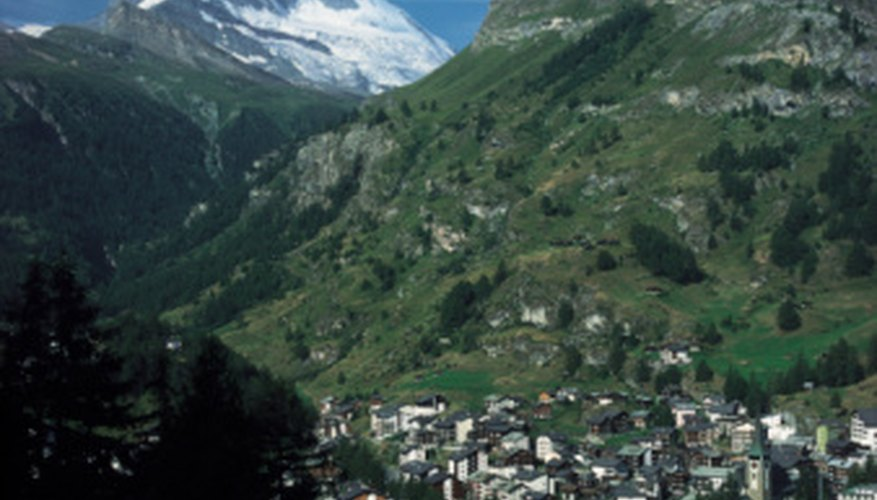 Towns nestled deep in valleys are often under mountain shadows.