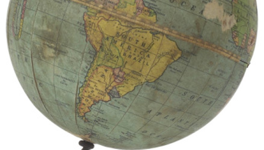 Globes illustrate the rotational axis of the Earth as well as the continents.