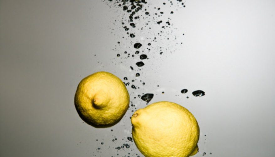 Citric acid in lemons reacts with the carbon dioxide in Pop Rocks.