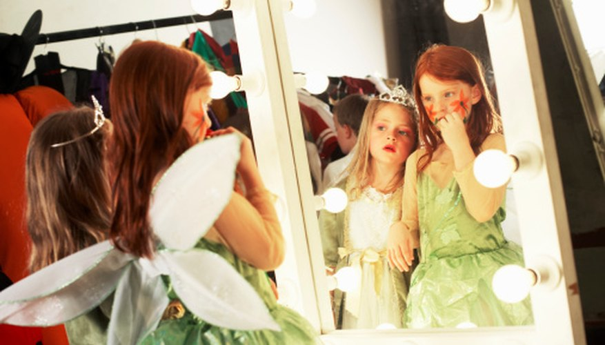 Face paints add the finishing touch to a fairy princess costume.