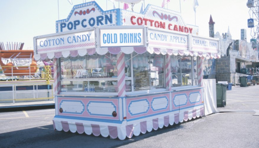 Carnival food vendors sell such items as popcorn and cotton candy.