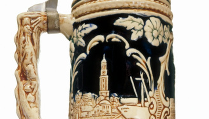 Imitation beer steins are designed to look almost identical to the genuine article, but small differences help collectors determine which are authentic.