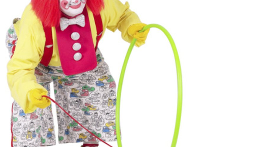 Create a clown skit that spoofs animal tricks or lion taming.