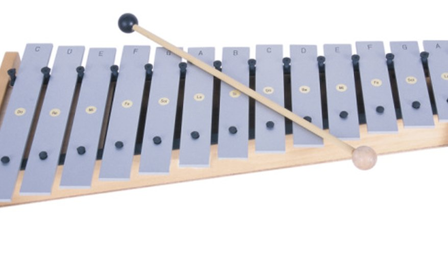 A glockenspiel is similar to a xylophone is its layout, but it has small, metal bars.