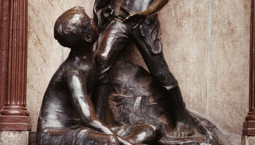 Bronze statues are often covered by a dark patina that protects the bronze.