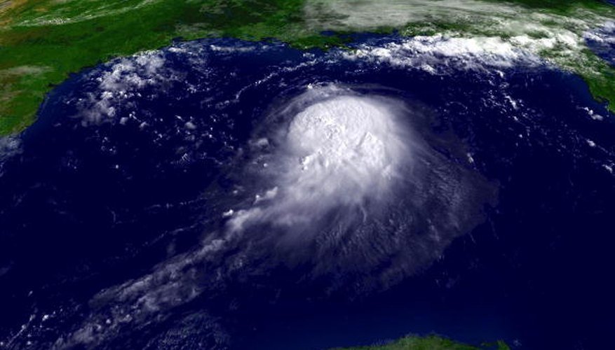 Satellite image of the swirling cloud formation in the early stages of a tropical revolving storm.