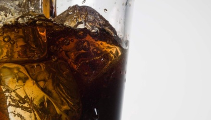 Decaffeinated sodas are better than caffeinated, but water is a healthier choice.