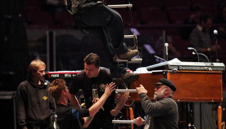 Bruce Springsteen's crew rig up the lights.