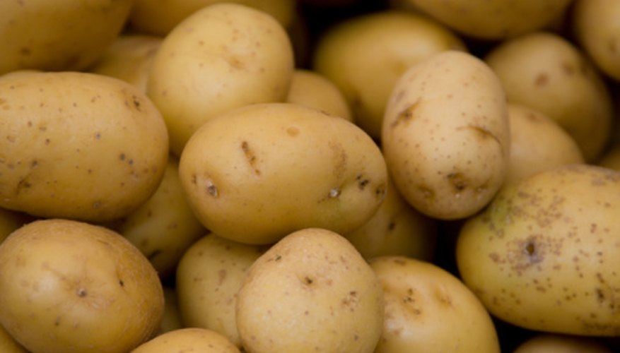 Potatoes contain phosphoric acid, which facilitates chemical reactions.