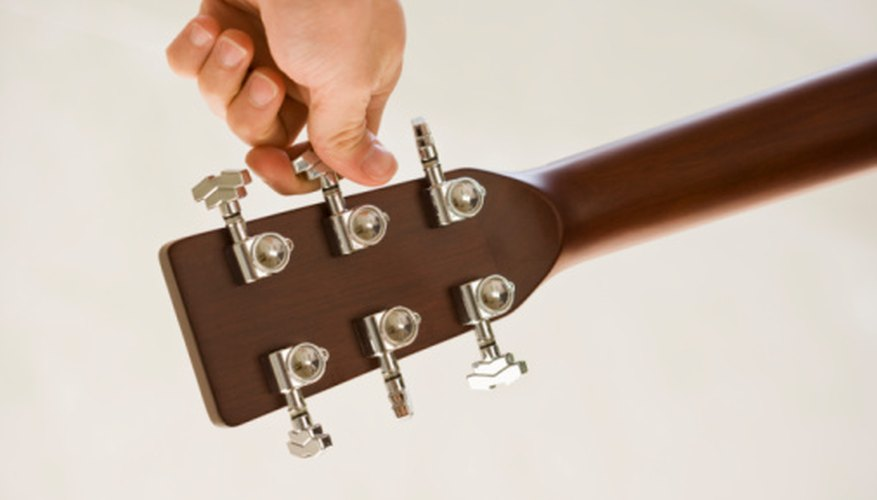 Check for loose tuning machines by playing a note and holding them.