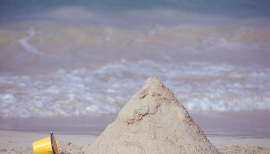 Wet sand has a higher angle of repose than dry sand. And it makes better sand castles.