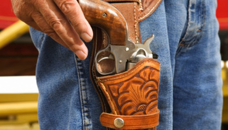 Holster leg thongs secure the bottom of the holster to the leg for security and a quicker draw.