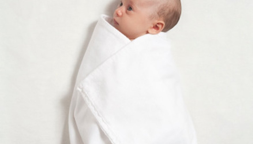 Newborn babies should be wrapped in warm receiving blankets.