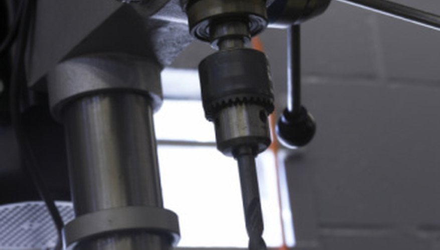 Use a carbide bit and a drill press when drilling into hard steel.