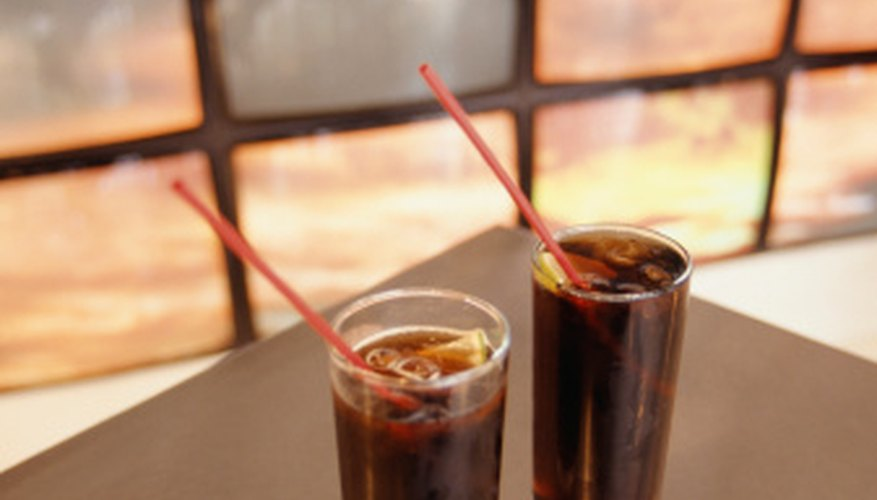 Cola, a plant native to Ghana, is used to flavor soft drinks.