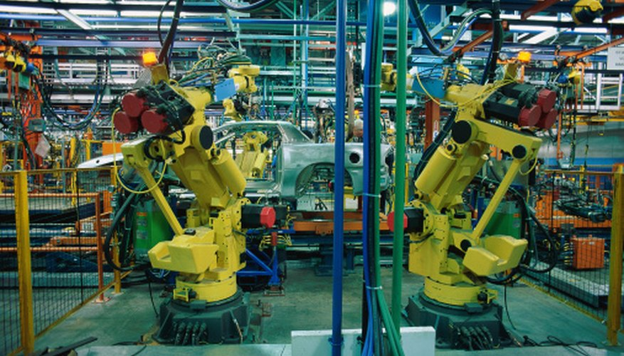 Mechanized robots are replacing humans in manufacturing.