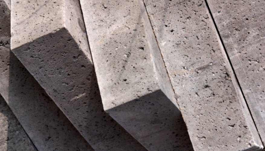 Concrete is popular, widely available, inexpensive and strong.
