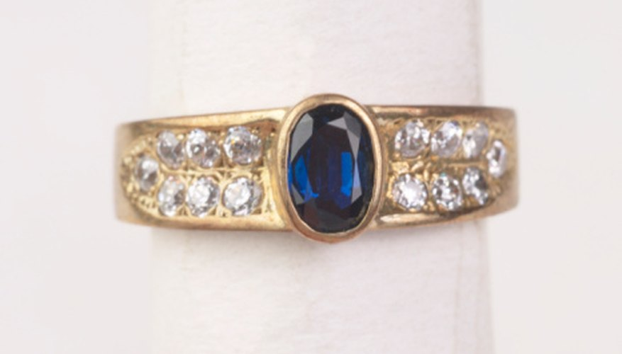 Blue sapphires, like the center stone shown here, are popular for jewelry.