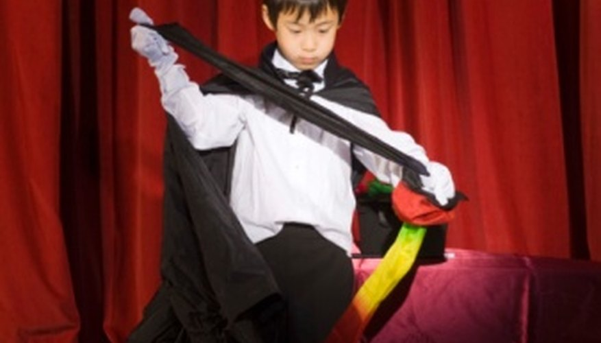 Children can learn easy magic tricks using common household items.
