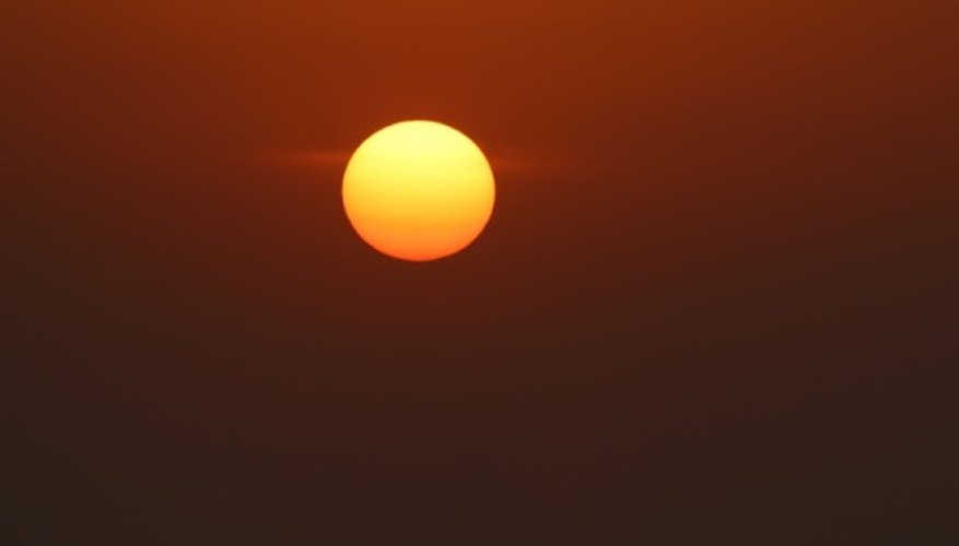 A hazy orange sunset indicates there is a temperature inversion.