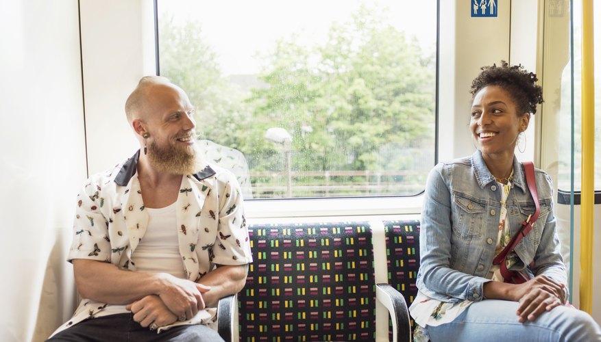 Man and woman flirting on a train.