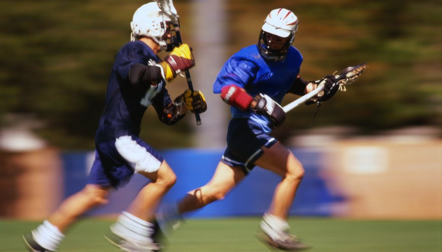 Lacrosse Players Running on Field