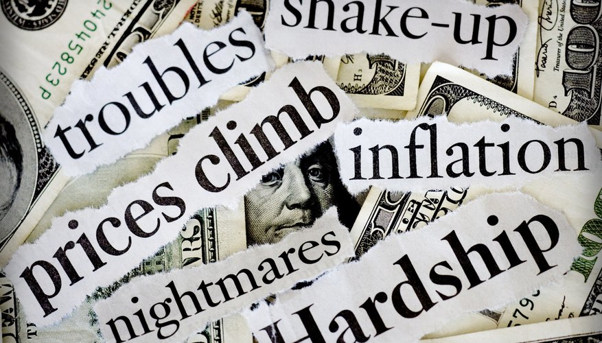 Close-up of newspaper clipping of finance hard times