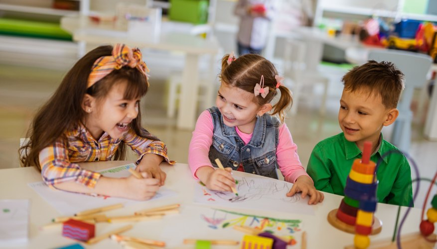 Hy Kids Talking While Drawing In Preschool Starting A Business
