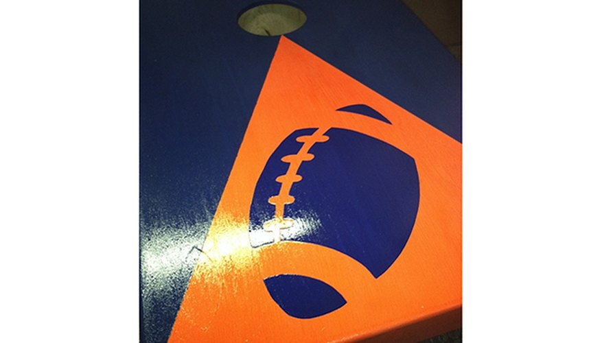 Building your own cornhole boards are a fun way to rep your team colors.