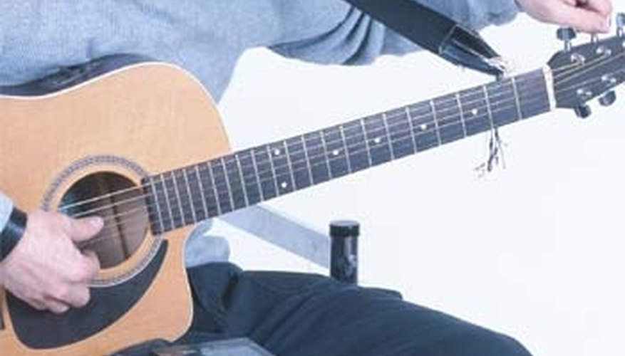 how to tune a guitar with a tuner our pastimes. Black Bedroom Furniture Sets. Home Design Ideas