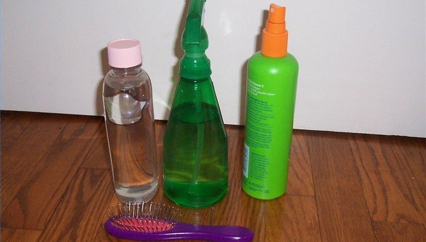 Spray bottle, baby oil, leave-in conditioner, doll brush